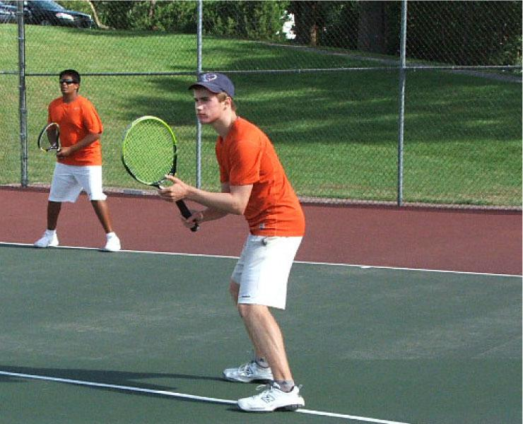 """Sophomores Keeshev Seetharaman and Trevor Macks prepare to return a serve during doubles practice. The two helped lead the young team to the regionals and an impressive record in the MAC Blue as doubles partners. """"The two of them were impressive,"""" Farr said. """"They can improve even more next year."""""""