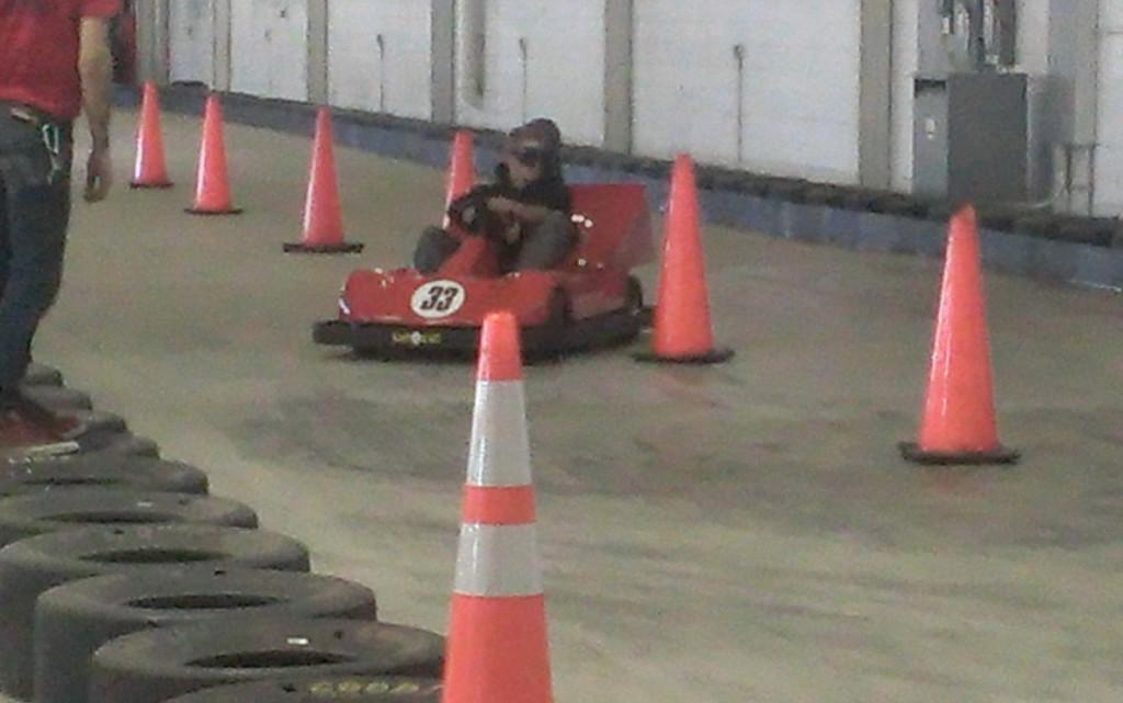 Wearing impaired/drunk goggles, senior Sam Goepper navigates through cones.