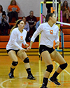 Seniors Sara Baum and Gina Duff in defensive position waiting for the ball to come over the net.