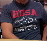 This is the Design of the Utica 2015-16 HOSA shirts,  being worn by Senior Marshal Tan.