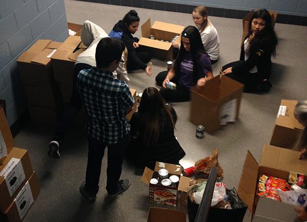 In the stairwell near the main office, Key Club members sorted and boxed food items that were donated during their annual drive.