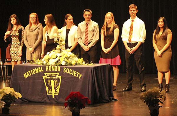 National Honor Society executive board members prepare to welcome new members at the induction ceremony Dec. 8.