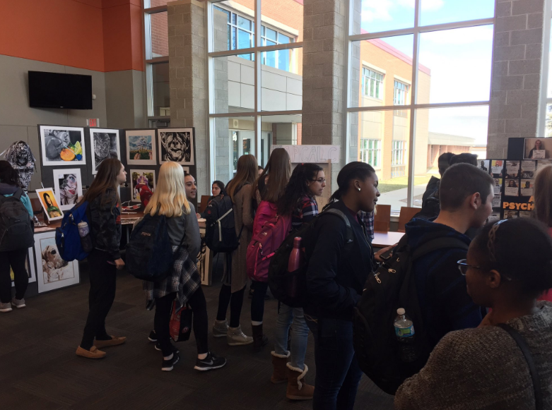 Students tour the media center to gather information about classes offered. AP class information was available Thursday, while elective classes were featured Friday.