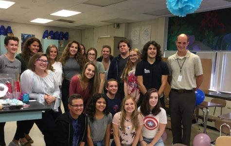 Teacher Bryant Sebastian's sixth hour poses after surprising Sebastian with a baby shower.