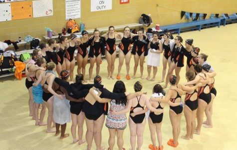 The girls prepare to cheer before a previous meet.