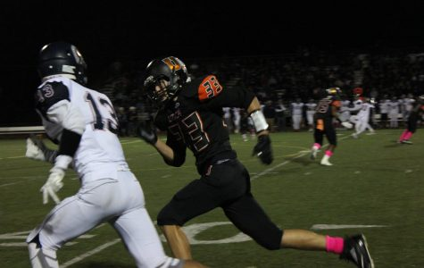 Senior Tyler Sulik catches up to his opponent, defending an incoming pass.