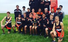 The boys cross country team poses after a meet.