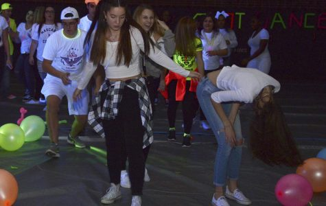 Gym lights up after exams at 'glow-out' dance