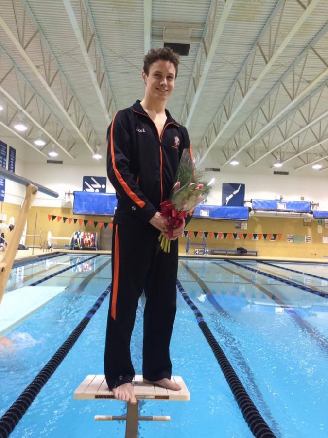 Senior Kyle Shock poses after his Senior Night meet.