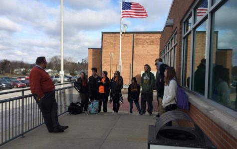Principal Tom Lietz speaks with a group of students that participated in the National School Walkout on March 14.