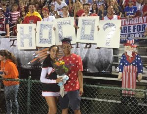 Senior Jacob Joseph asks senior Julia Meguid to homecoming at one of the home football games