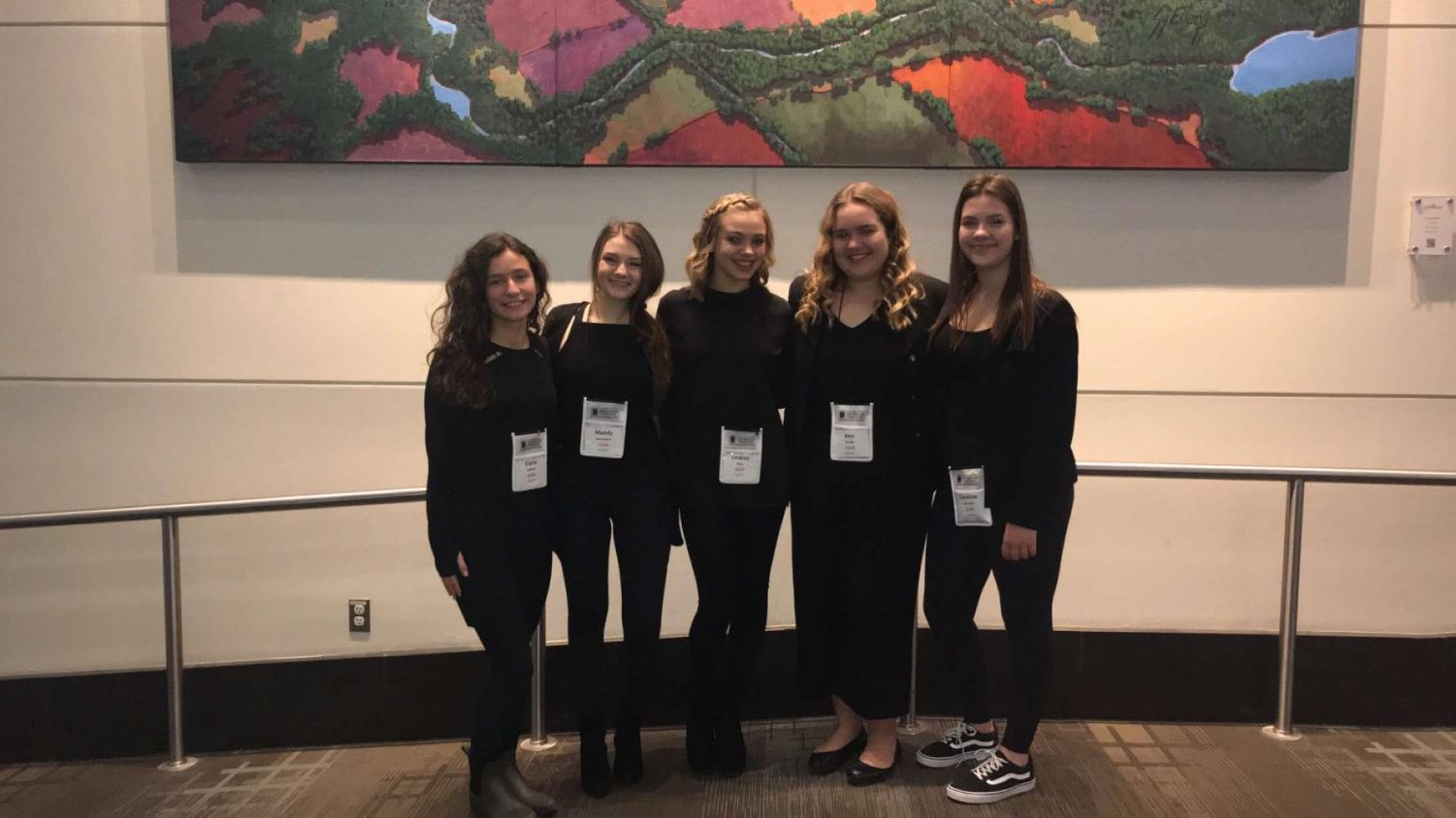Students pose in their all-black outfits, which are required for all technical and performance events.