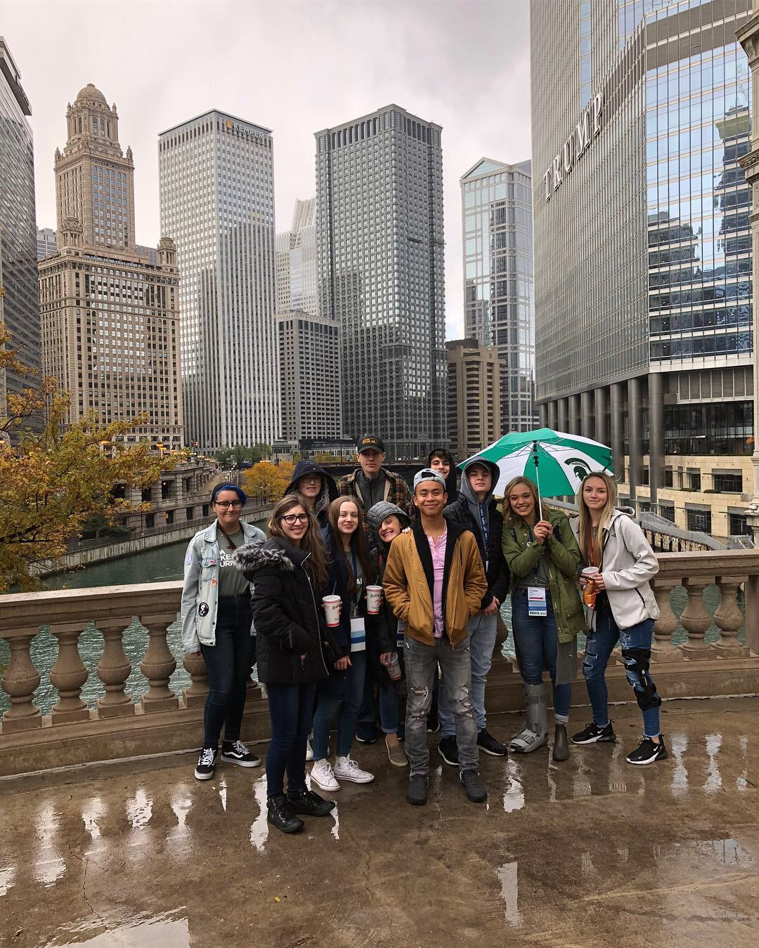 205 crew takes a picture in front of the Chicago skyline.