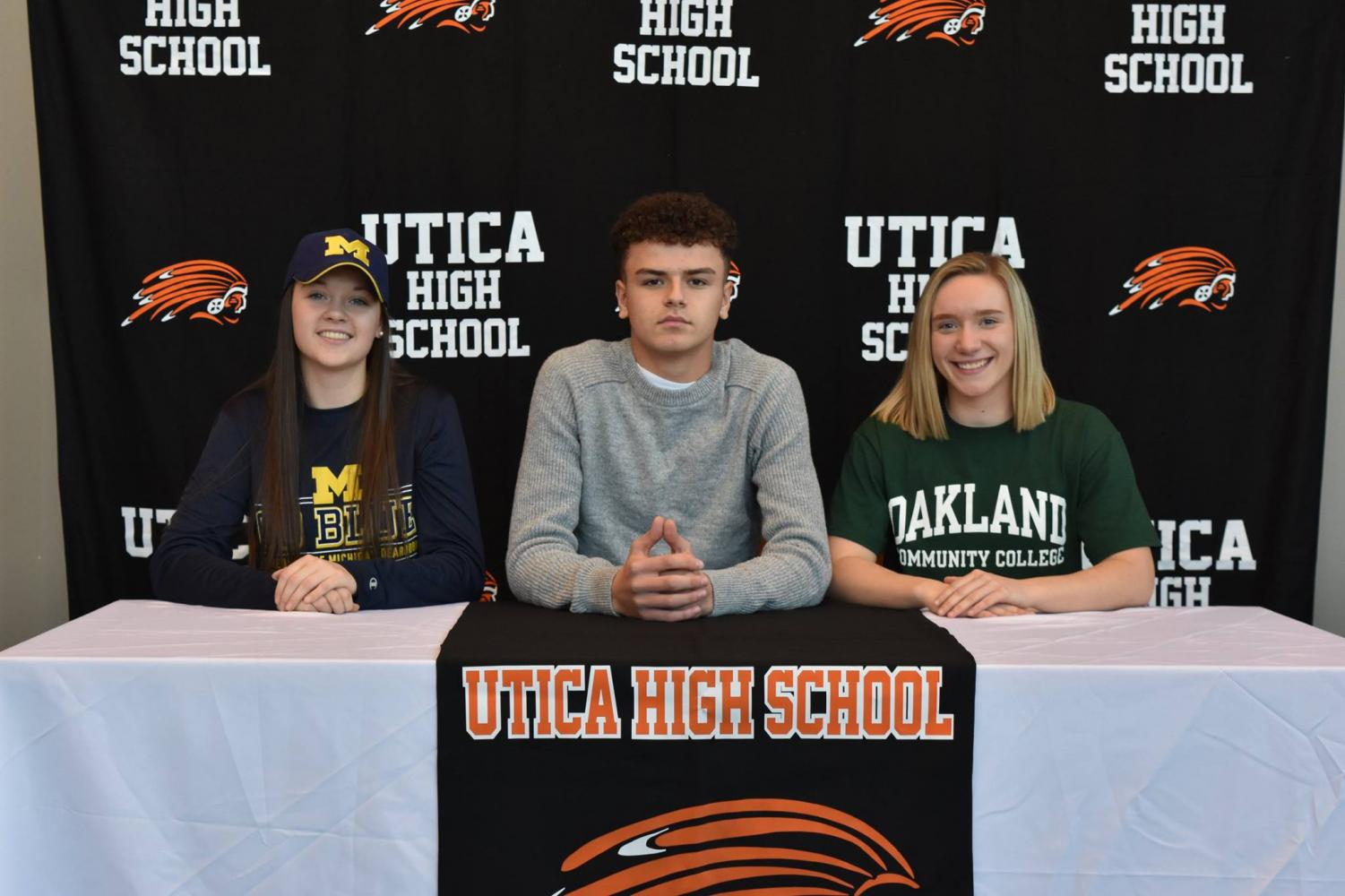 seniors Caitlyn Mauser, Marko Matovski and Lindsey Michol are ready to sign their commitment papers for college.  Diann O'Connor photo