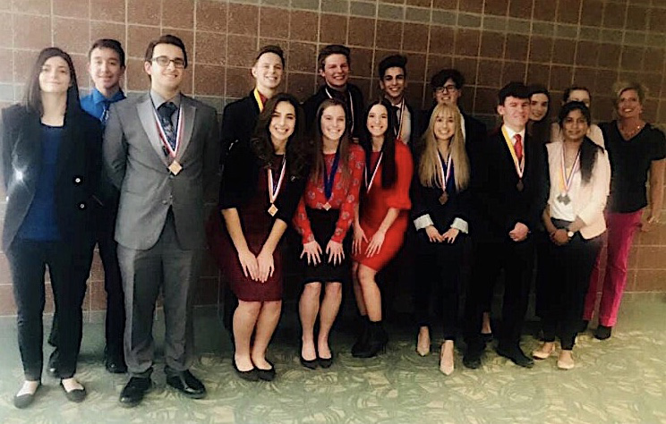 DECA state qualifiers pose after receiving their placements at districts. DANA BOICE PHOTO