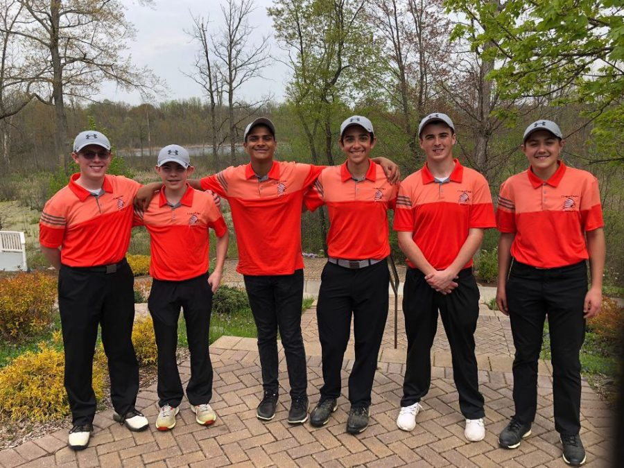 The golfers pose for a photo during a match. Pictured left to right: junior Charles Borus, freshman Jacob Hill, sophomore Anand Seetharaman, senior Quinn Rennell, junior Mitchell Ramsey, freshman Conner Rennell.