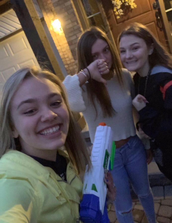 After eliminating senior Isabella Chirco,  senior Lindsey Berg takes a photo with her teammate, senior Madison Herrington.