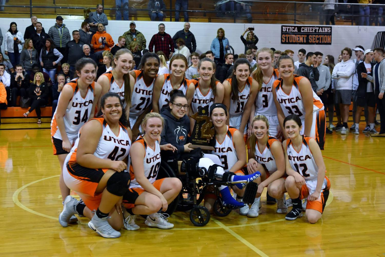 The team pictured after winning the district finals.