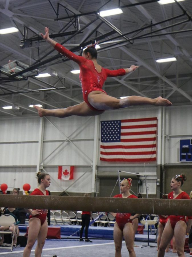 Senior Isabel Redmond leaps during competition.