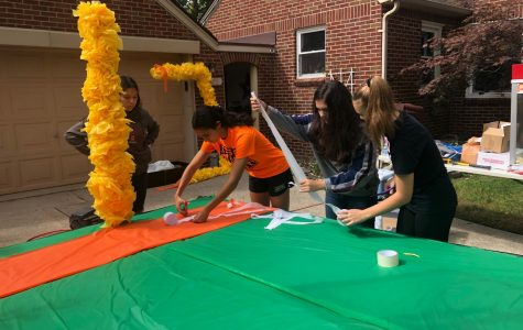 Sophomores add details to their homecoming float, a haunted football field.