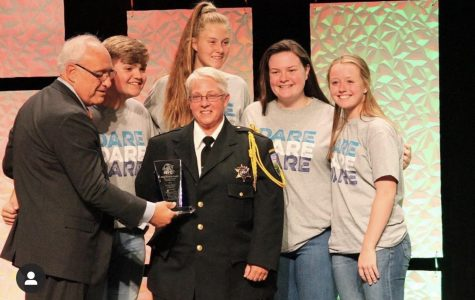 Jack Droelle (Left) at a D.A.R.E Award with the Officer of the year @midareyab