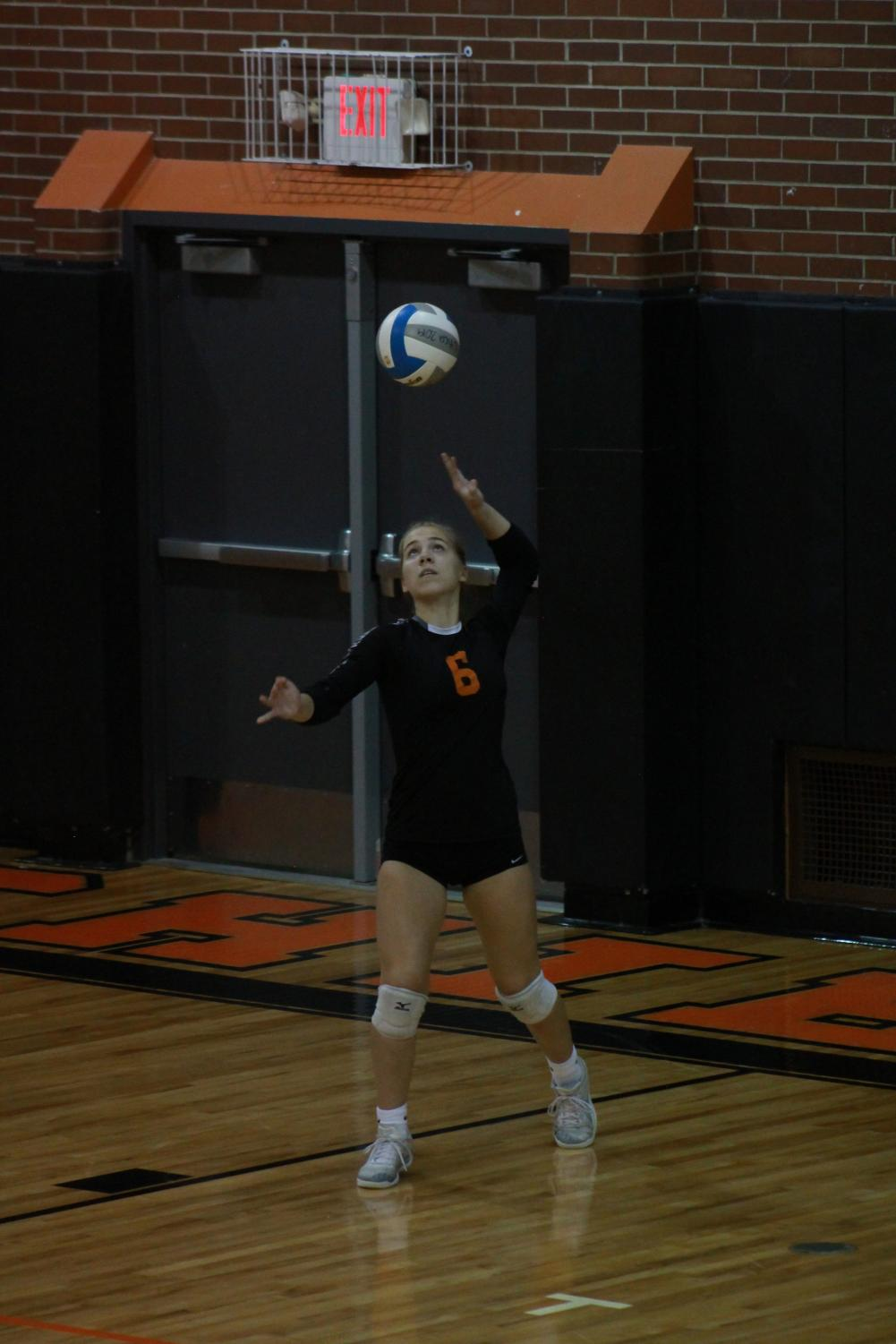 """You're so focused on getting it hard and in, but when you hit it hard you have the possibility of making an error, so you just have to trust yourself and just serve it as hard as you can,"" junior Alyssa Jacob, number 6, said."