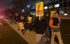 Teachers gather in front of Utica for another rally