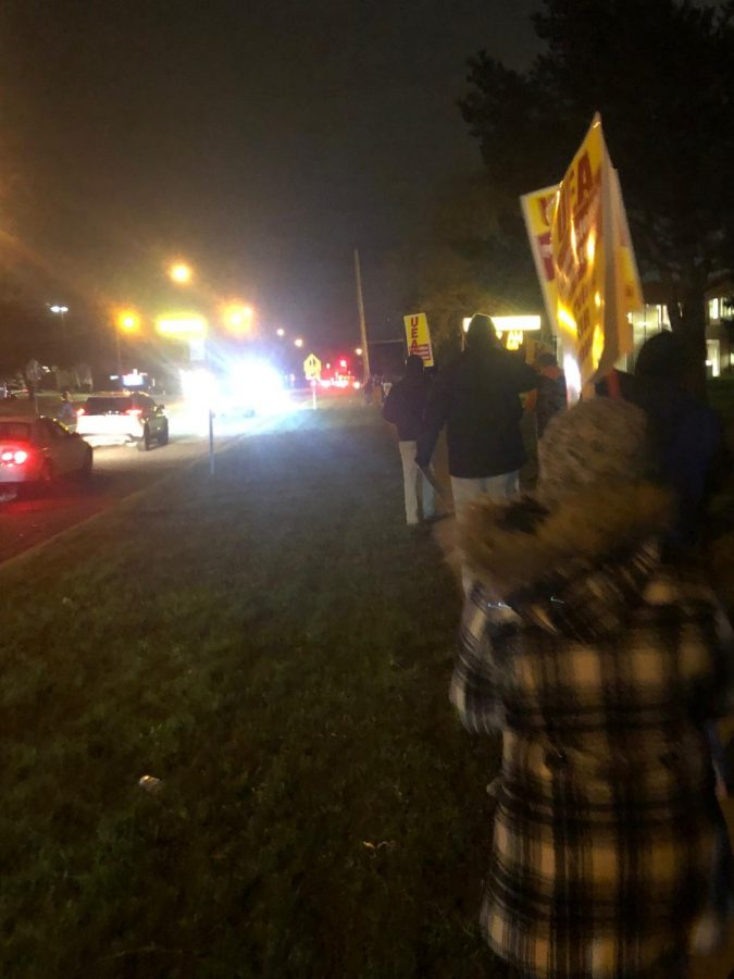 Teachers rallied in the 30 degree weather outside Utica in the dark.