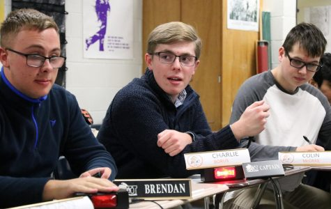 Borus leads his team in a Quiz Bowl match.