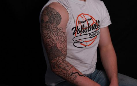 Senior Adian Rick was tattooed by his father in their family tattoo shop.