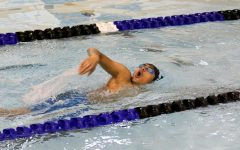 Swimming at the home pool at Eisenhower High,  sophomore Om Bidja competes in a race.