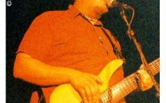 Principal Thomas Lietz played bass for 'The Foolish Heads' at the Magic Stick on Jun. 20, 2001.