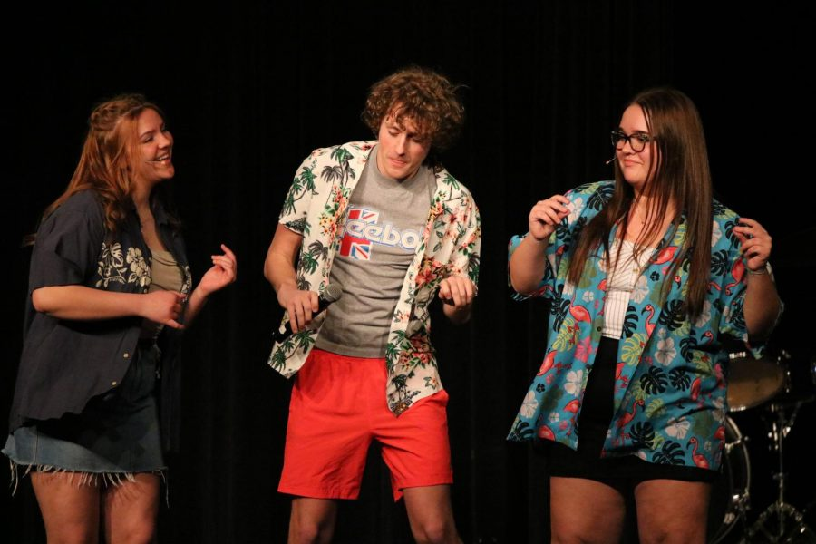 Juniors Annie Droelle and Caroline McDade were emcees for the show, but they also joined senior Josh Essemacher during his performance.