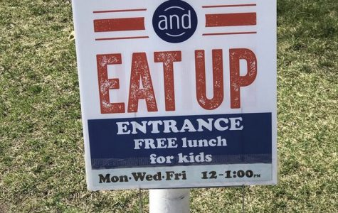 Signs are posted outside of every location of the food distribution centers for students and families.