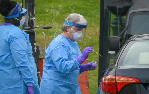 This is a drive-up testing site for possible COVID-19 patients. Not everyone can be tested for COVID-19, but in order to get tested, one has to contact a local healthcare provider. These healthcare workers are wearing CAPRs, N95 masks, gloves, and gowns to protect themselves.
