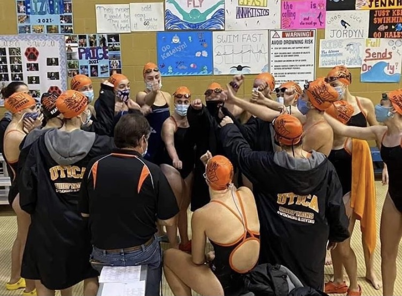 Utica Girl's Varsity Swim Team all cheers together after defeating L'anse Cruese 102-55