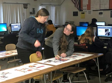 In the news room at Utica High, editors Cassidy Eskew and Lauren Kerr edit yearbook proofs before they are sent out for publication in the yearbook.