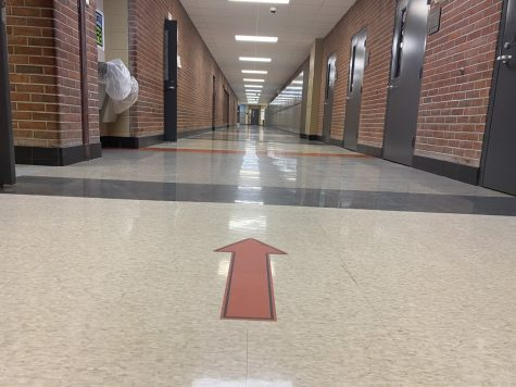 After heading up the stairway on the south end of the school, students must follow the one-way traffic indicated by arrows.