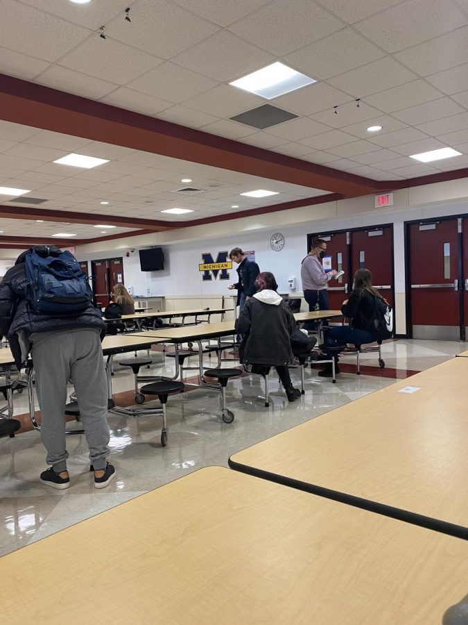 Students at lunch cleaning up and wiping down their spot before having to return back to class.