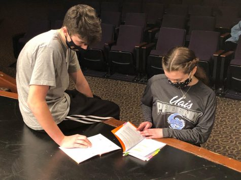 """Douglas Gettleson & Julie Syler going over lines for the upcoming play, 'Crafting a Killer"""""""