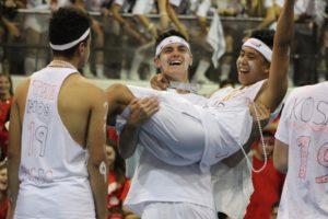 Senior Jacob Joseph is lifted for the cheering crowd after the boys won the tug-of-war during the 2018 competition assembly.